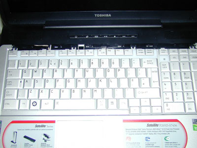 Without the bezel you can access the 4 small screws which hold the keyboard in place